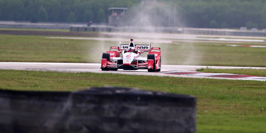 The No. 2 Verizon Team Penske Chevrolet of Juan Montoya throws up a spray during a wet second practice session.  (Photo Courtesy of IndyCar - Brett Kelly)