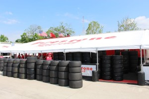Under blue skies, the Firestone crew was very busy mounting up rain tires before race #1 at Detroit