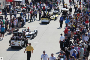Fans watch the cars leave Gasoline Alley.