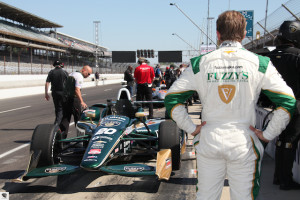 Ed Carpenter looks at his car prior to practice today.