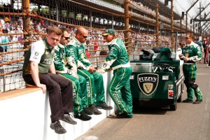 Ed Carpenter's crew takes a break before the race.