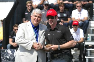 Simon Pagenaud accepts his ring for qualifying in the 99th running of the Indianapolis 500.