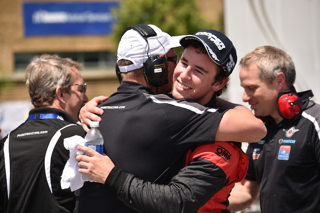Pabst Racing sophomore USF2000 pilot Jake Eidson has led the most laps so far in 2015.  Here he is being congratulated by his engineer and driver coach Tonis Kasemets. (Photo courtesy of Indianapolis Motor Speedway, LLC Photography)