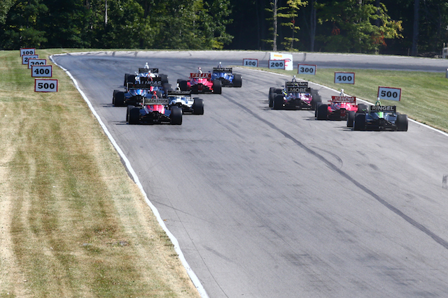 The Indy Lights presented by Cooper Tire series drivers stream towards Turn 4 after taking the green flag in their second race of the Mid-Ohio weekend.  (Photo courtesy of Indianapolis Motor Speedway, LLC Photography)