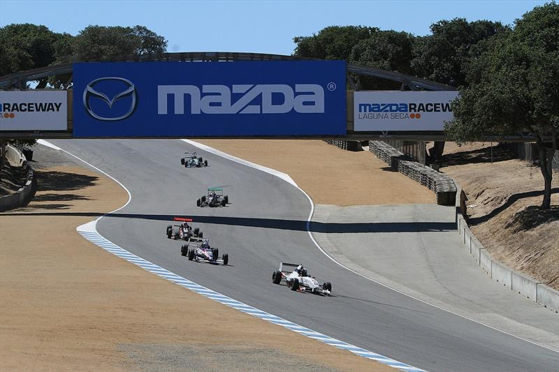 A group of Cooper Tires USF2000 powered by Mazda stream downhill at Mazda Raceway Laguna Seca in 2013 (Photo Courtesy of Andersen Promotions)
