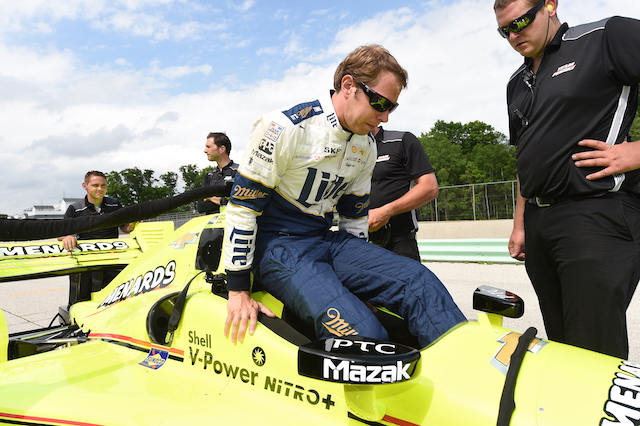 NASCAR star Brad Keselowski gets ready to get strapped into the No. 22 Menards Chevrolet of his Team Penske teammate Simon Pagenaud. (Photo Courtesy of IndyCar - Chris Owen)